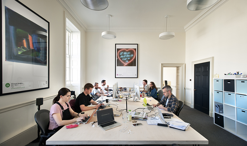 A light and airy office space with people working at computers