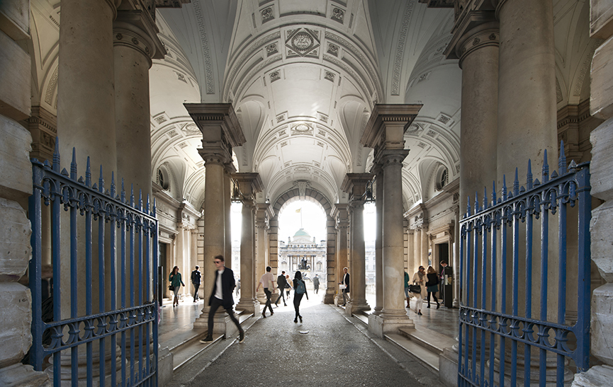 People cross the Somerset House Strand Entrance which looks through to the sunlit courtyard